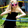 Newburyport: Maggie Budzyna, 9, does her best at the hula hoop contest at Old-Fashioned Sunday on the Bartlet Mall In Newburyport. Jim Vaiknoras/Staff photo