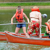 Newburyport: Casie Sharp, standing, and Maureen Moore battle Dave Adolph and Kevin Moore in the canoe tilt at Old-Fashioned Sunday on the Bartlet Mall In Newburyport. Jim Vaiknoras/Staff photo