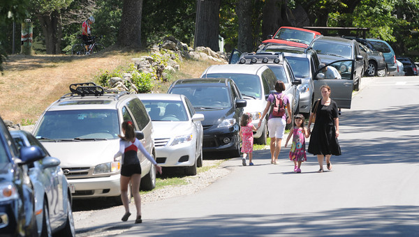Newburyport: With the parking lot full, cars had to park along the road leading into the park at Yankee Homecoming's Family Day at Maudslay Saturday afternoon.  Jim Vaiknoras/Staff photo