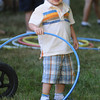 Newburyport: Thomas Fitzgerald, 2, of Framingham plays with a hula hoop  at Yankee Homecoming's Family Day at Maudslay Saturday afternoon. His family is originally from Newburyport and they return every year for Homecoming. Jim Vaiknoras/Staff photo