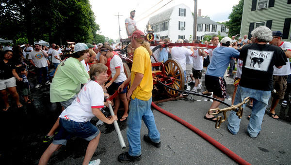 Newburyport: Protection #1 of Newbury works their hand tub at the annual muster at Old-Fashioned Sunday in Newburyport. Jim Vaiknoras/Staff photo