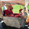 Newburyport: Braiden Eastman, 3, left, Salisbury, and Alaina Evers, 10 months, of Salisbury dress up as pioneers in the Carriage and Bike Parade for Kids Day in the Park. Bryan Eaton/Staff Photo