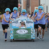 Newburyport: The team from the Grog makes it's way down Federal Street in the Yankee Homecoming Bed Race in Newburyport Thursday night. Jim Vaiknoras/Staff photo