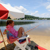 Amesbury: Life guard Dana Hubbard of Haverhill keeps watch on Lake Gardner in Amesbury on a quiet Sunday morning. Jim Vaiknoras/Staff photo