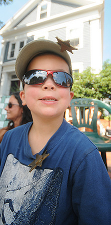 Newburyport: Colin Twomey, 3, is cool in his shades as he watches the Yankee Homecoming Parade Sunday. Jim Vaiknoras/Staff photo