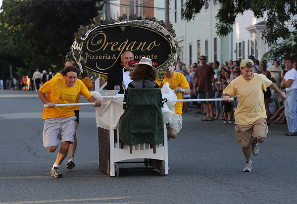 Newburyport: The entry from Oregano's makes it's way down Federal Street in the Yankee Homecoming Bed Race in Newburyport Thursday night. Jim Vaiknoras/Staff photo