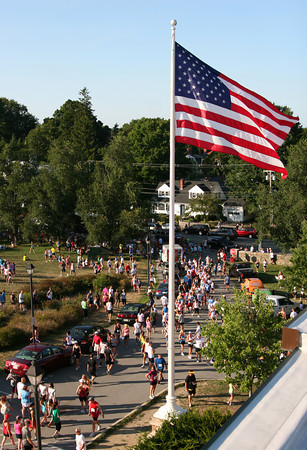 Newburyport: Crowds of runners gather at Newburyport High School prior to the 50th annual Yankee Homecoming Road Race Tuesday night. Photo by Ben Laing/Staff Photo