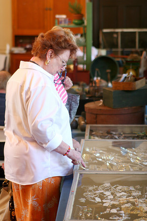 Newburyport: Peg McClure of West Newbury browses some jewlery on sale at the Belleville Churche's annual Yankee Homecoming antique show and sale, Monday morning. Photo by Ben Laing/Staff Photo