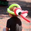 Newburyport: A young boy watches a performance in Market Square Wednesday morning while wearing a balloon hat from Mr. Dees, a balloon artist set up downtown. Photo by Ben Laing/Staff Photo