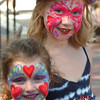 Newburyport: Sisters Laura Piekarski, 4, and Sophia, 6, of Upton show off their face paintings in Market Square. They were visiting Newburyport with their grandparents Tom and Mary Carey of Haverhill. Bryan Eaton/Staff Photo