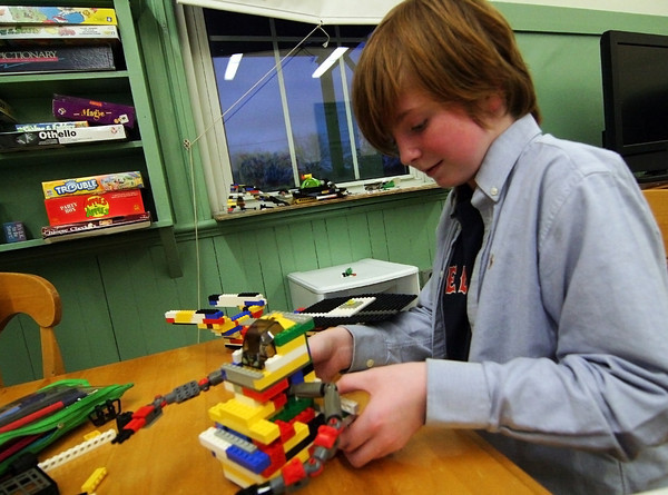 Newburyport: Jefferey Popkin, 12, of Newburyport, constructs a Lego creation Monday afternoon at the drop in center at the Kelley School. Photo by Ben Laing/Staff Photo
