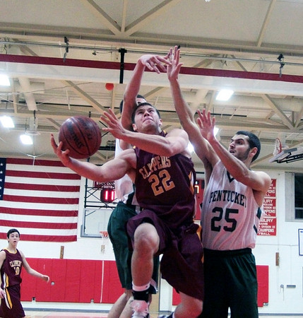 Amesbury: Newburyport's Matt Mattola (22) slices through two Pentucket defenders during Tuesday night's game. The two teams matched up in the first game of the 2nd annual Holiday Tournament doubleheader, with Pentucket advancing to the championship game. Photo by Ben Laing/Staff Photo
