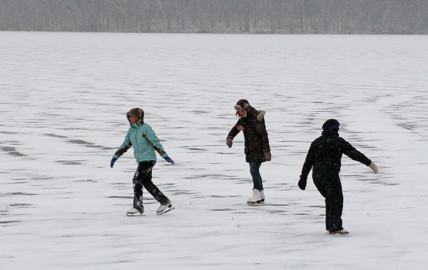 West Newbury: Monday's afternoon's snow fall couldn't keep this trio from enjoying the ice skating at the Artichoke in West Newbury. Photo by Ben Laing/Staff Photo