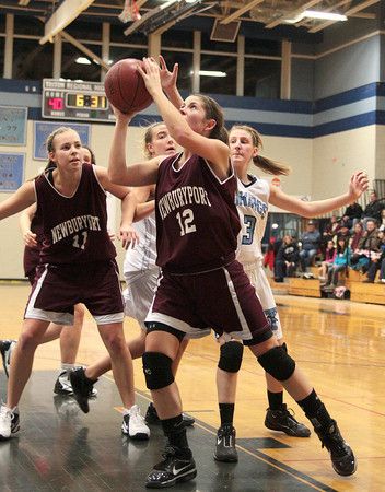Byfield: Newburyport's Molly Rowe (12) drives to the basket during Wednesday night's game against Triton. The Clippers won the Institution for Savings Holiday Tournament, defeating the Vikings 58-52. Photo by Ben Laing/Staff Photo