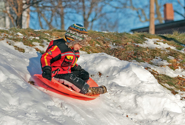 Newburyport: Brendan Currier, 5, of Philidelphia, slides down a hill at the Mall Wednesday afternoon. Brendan's family visits Newburyport often, as his father grew up here. Photo by Ben Laing/Staff Photo