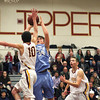 Newburyport: Newburyport's Ian Michaels (10) blocks a shot by Triton's Alex Mandragouras (34), as the Clippers cruised to a 82-54 victory Tuesday night. Photo by Ben Laing/Staff Photo