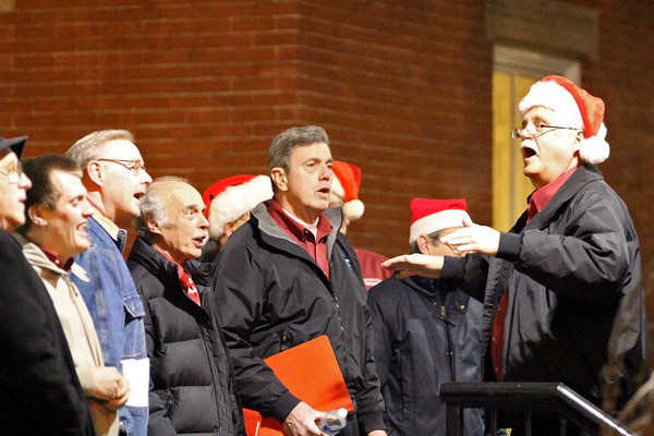 Newburyport: A group of carolers sing Christmas songs on the steps of the Newburyport Public Library Tuesday evening. Photo by Ben Laing/Staff Photo