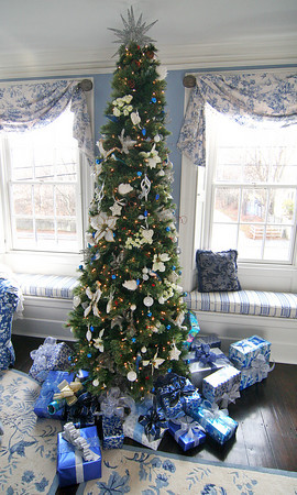 """Newburyport: The """"blue"""" room at 182 High Street has its own tree and Christmas presents on display for Saturday's Holiday House tour. Photo by Ben Laing/Staff Photo"""