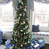"Newburyport: The ""blue"" room at 182 High Street has its own tree and Christmas presents on display for Saturday's Holiday House tour. Photo by Ben Laing/Staff Photo"