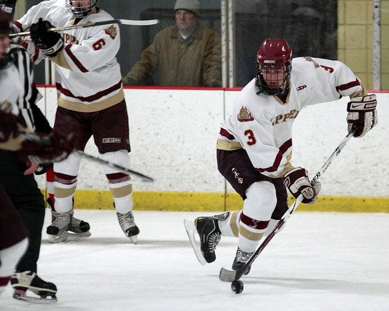 Newburyport: Newburyport defenseman Adam McElroy (3) moves the puck out of his own zone during Wednesday night's game against Amesbury. Photo by Ben Laing/Staff Photo