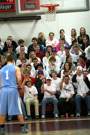 Newburyport: The crowd at Newburyport High tries to distract Triton's Jedd Hutchins (1) during Tuesday night's 82-54 Clipper victory. Photo by Ben Laing/Staff Photo