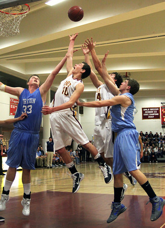 Newburyport: Newburyport's Ian Michaels (10) leaps for a rebound over Triton's John Manning (33) during Tuesday night's 82-54 win over the Vikings. Photo by Ben Laing/Staff Photo