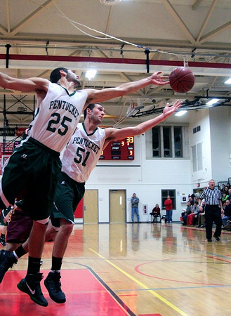 Amesbury: Pentucket's John Modlish (25) and Will Angelini (51) stretch for a loose ball during Tuesday night's win over Newburyport in the opening match of the 2nd annual Holiday Tournament at Amesbury High School. Photo by Ben Laing/Staff Photo