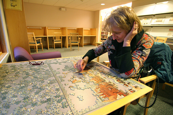 Merrimac: Virginia Hartling of Merrimac spends Monday afternoon completing a puzzle at the Merrimac Public Library. Photo by Ben Laing/Staff Photo