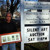 Amesbury: Val Troyli holds a print from Rachel Kohn, an local artist whose work will be part of this weekends silent auction at the Union Congregational Church in Amesbury. Photo by Ben Laing/Staff Photo