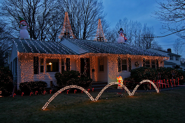 Newburyport: A Christmas light show is on display at  this home at 1 Rawson Hill Road in Newburyport. The lights are synched to music which can be heard by tuning your car stereo to a specific frequency. Photo by Ben Laing/Staff Photo