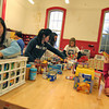 Newburyport: The kids at the drop in center at the Kelley School in Newburyport sort food that has been donated for needy families this Christmas. Photo by Ben Laing/Staff Photo