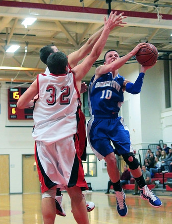 Amesbury: Georgetown's Tyler Wade (10) tries to avoid the outstreched arms of the Amesbury defense during Tuesday night's game. The two teams matched up in the second game of the 2nd annual Holiday Tournament doubleheader at Amesbury High School. Photo by Ben Laing/Staff Photo