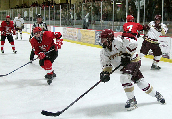 Newburyport: Newburyport's Gaven LaValley (7) skates the puck out of the corner during Wednesday night's game against Amesbury. Photo by Ben Laing/Staff Photo