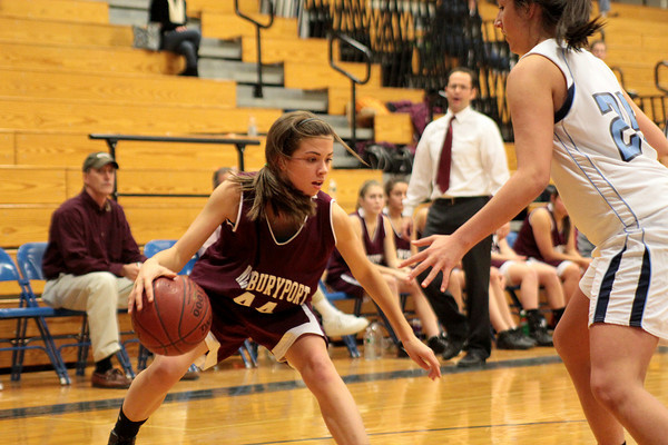 Byfield: Newburyport's Alyssa Leahy (44) look to drive down the baselline during Wednesday night's game against Triton. The Clippers won the Institution for Savings Holiday Tournament, defeating the Vikings 58-52. Photo by Ben Laing/Staff Photo