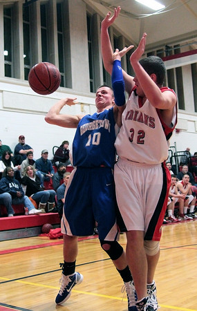 Amesbury: Georgetown's Tyler Wade (10) and Amesbury's Curran O'Connor (32) try to avoid touching a ball on its way out of bounds during Tuesday night's game. The two teams matched up in the second game of the 2nd annual Holiday Tournament doubleheader at Amesbury High School. Photo by Ben Laing/Staff Photo