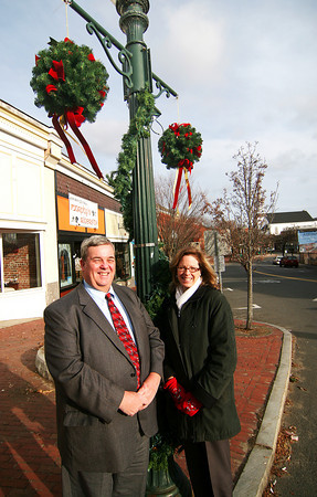 Amesbury: Richie Eaton, President of the Newburyport Bank, and Ann Bonaventura of the Amesbury Chamber of Commerce, stand near some Christmas decorations in downtown Amesbury. The Newburyport Bank donated $6000 to the chamber to provide decorations. Photo by Ben Laing/Staff Photo