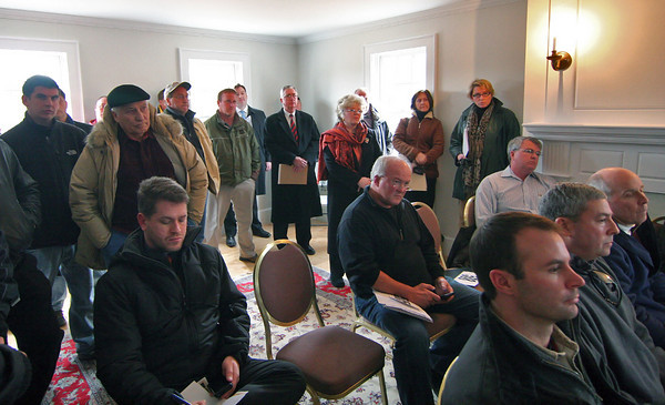 Newburyport: Prospective buyers fill a room at a new home on Russell Terrace in Newburyport Wednesday afternoon, as the home, along with 47 additional acres were up for auction. Photo by Ben Laing/Staff Photo
