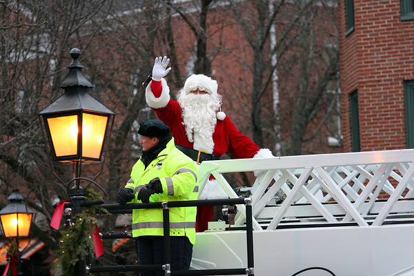 Newburyport: Santa Clause rides through downtown Newburyport Sunday afternoon atop a fire engine as the annual Santa parade snaked its way through the city. Photo by Ben Laing/Staff Photo