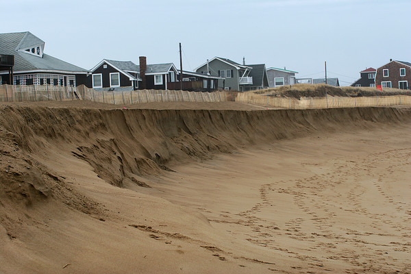Newbury: Only months after the beach on Plum Island was filled in with sand from the dredging of the Merrimack River, erosion has already began to wash the sand away. Photo by Ben Laing/Staff Photo