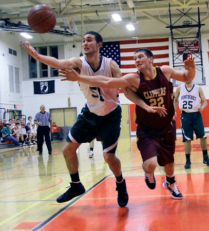 Amesbury: Newburyport's Matt Mattola (22) and Pentucket's Will Angelini (51) dive for a loose ball during Tuesday night's game. The two teams matched up in the first game of the 2nd annual Holiday Tournament doubleheader, with Pentucket advancing to the championship game. Photo by Ben Laing/Staff Photo