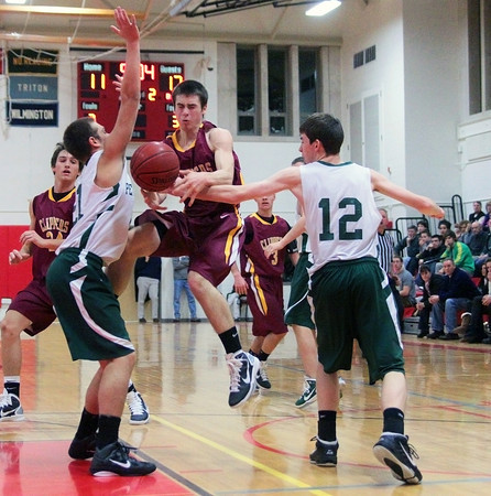 Amesbury: Pentucket's Corey McNamara (12) knocks the ball loose from Newburyport's Chris Jayne (5) during Tuesday night's opening game of the 2nd annual Holiday Tournament at Amesbury High School. Pentucket will advance to the championship game after beating the Clippers. Photo by Ben Laing/Staff Photo