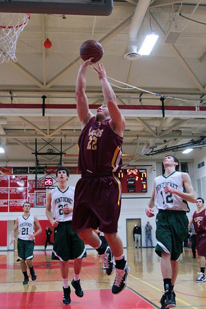 Amesbury: Newburyport's Matt Mattola (12) glides in for a lay up during Tuesday night's game against Pentucket. The two teams matched up in the first game of the 2nd annual Holiday Tournament doubleheader, with Pentucket advancing to the championship game. Photo by Ben Laing/Staff Photo