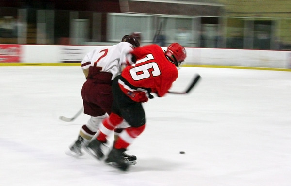 Newburyport: Newburyport's Billy Boudreau (2) and Amesbury's Aaron Sanford (16) battle for a loose puck during Wednesday nights game at the Graf Rink. Photo by Ben Laing/Staff Photo