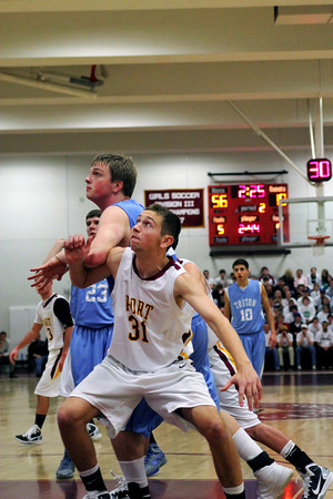 Newburyport: Newburyport's AJ Macdougall (31) battles with Triton's John Manning (33) for a rebound Tuesday night as the Clippers cruised to a 82-54 victory. Photo by Ben Laing/Staff Photo