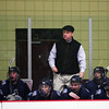Newburyport: Triton head coach, Drew Wile, watches his Vikings work the powerplay during Wednesday night's season opener againt Amesbury. Photo by Ben Laing/Staff Photo