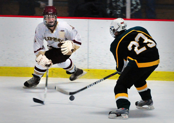 Newburyport: Newburyport's Tyler Cusack tries to blocks North Reading's Jonathan Gravallese. Bryan Eaton/Staff Photo