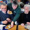 Merrimac: State Rep. Harriet Stanley hands out carrot cake to Bob Lattimore, left, and Altha Ottman at the Merrimac Senior Center on Monday afternoon. Stanley was the guest chef and made up several types of lasagna for lunch there, including a lobster lasagna. Bryan Eaton/Staff Photo