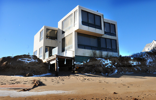 Newburyport: Some relief may be on the way for homes on Plum Island that are threatened by erosion. This home, owned by Dr. Hemani at 55th Street, has lost dozens of yards of dune over the years. Bryan Eaton/Staff Photo