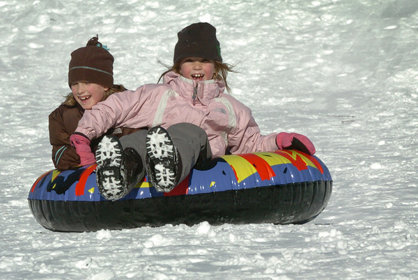 Newburyport: The snow storm that dumped a foot of snow in the area came in time for students school vacation this week. Sliding down at March's Hill in Newburyport yesterday morning were Abby Maines, 8, left, and Sierra Leahy, 7, both of Newburyport. Bryan Eaton/Staff Photo