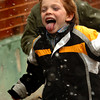 Amesbury: Luke Chapman, 7, runs after snowflakes as they began to fall while at recess at Amesbury Elementary School yesterday afternoon. More snow may in the forecast Sunday into Monday morning. Bryan Eaton/Staff Photo